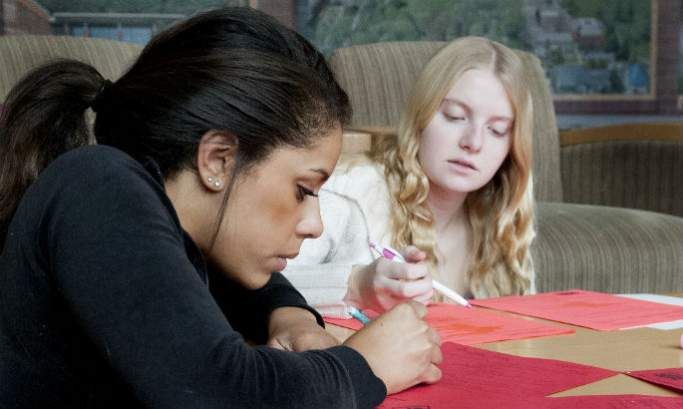 Two students studying at a table