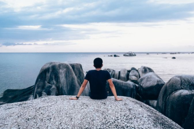 Photo of a student looking out to sea