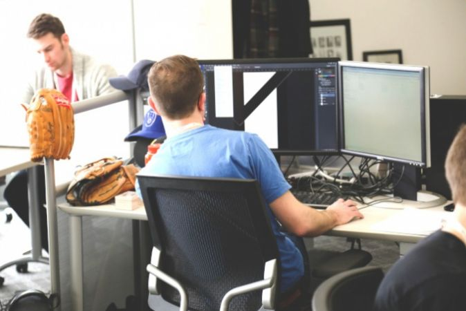 Photo of a young man at a computer