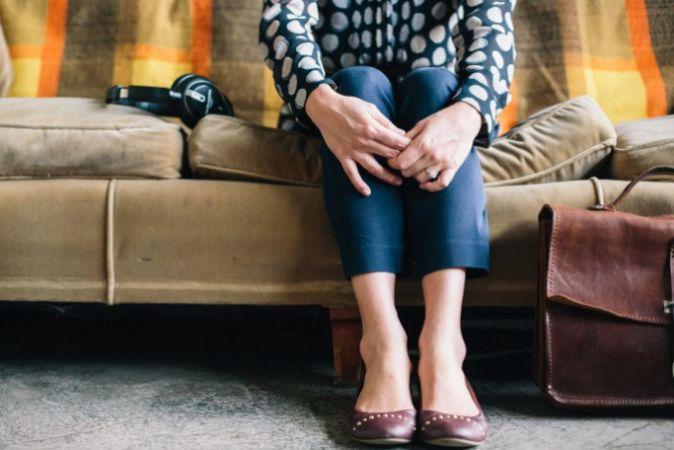 Woman sitting on a sofa
