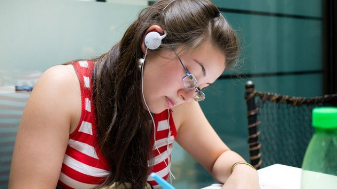 Girl studying with headphones on