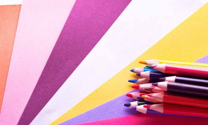 Pencils lying on a colourful background