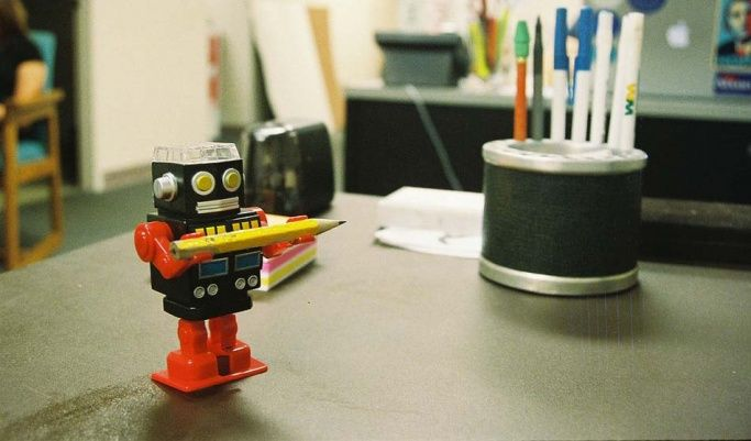 Robot standing on a desk