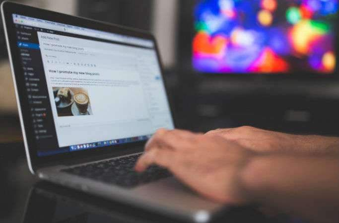 Photo of someone adding employability skills to their CV on a laptop