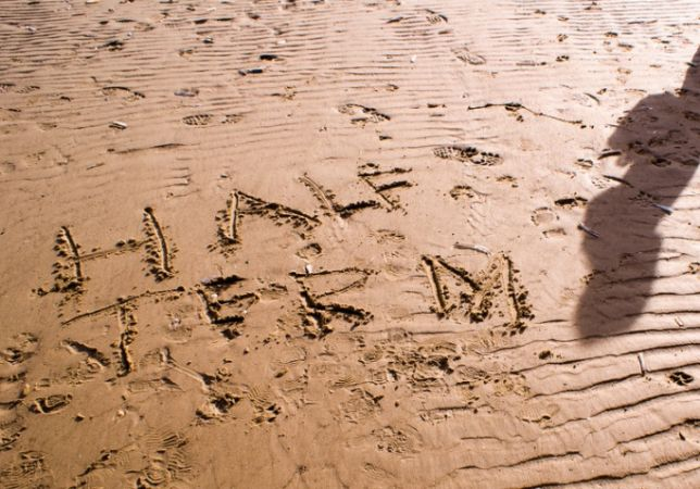 'half term' written in the sand