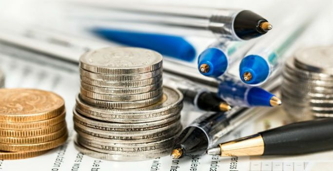 Coins and pens, representing asset management