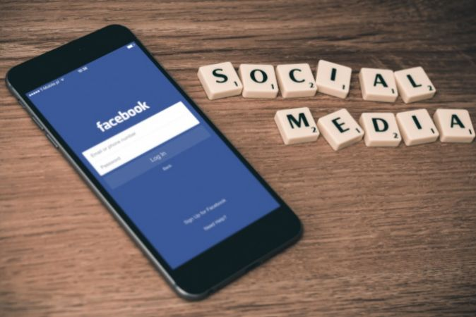Photo of a phone showing a Facebook login page