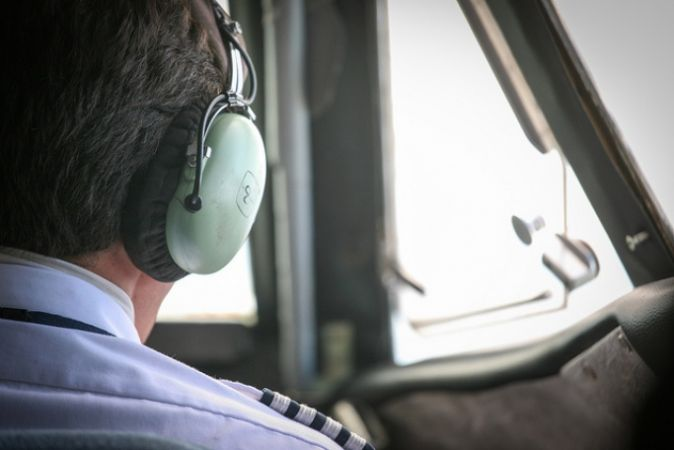 Airline pilot in the cockpit