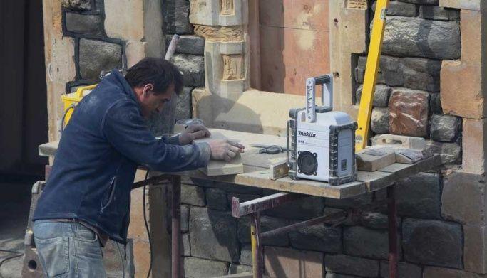 Stone mason cutting stone