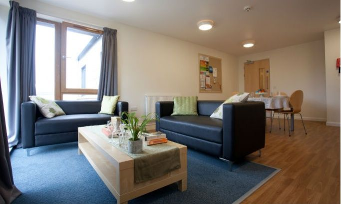 Student accommodation with sofas, a coffee table and dining table