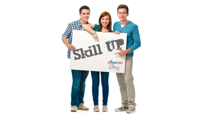 Three students holding up a sign that reads 'skill up'