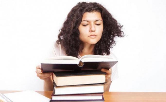 Girl reading a book at a desk
