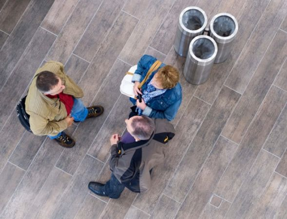 Photo of three people talking from above