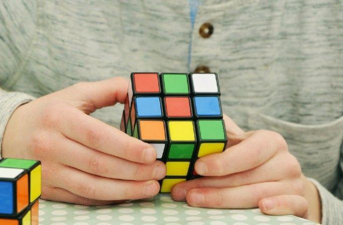 Boy completing a Rubix cube