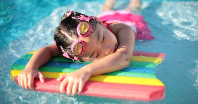 Child taking swimming lessons