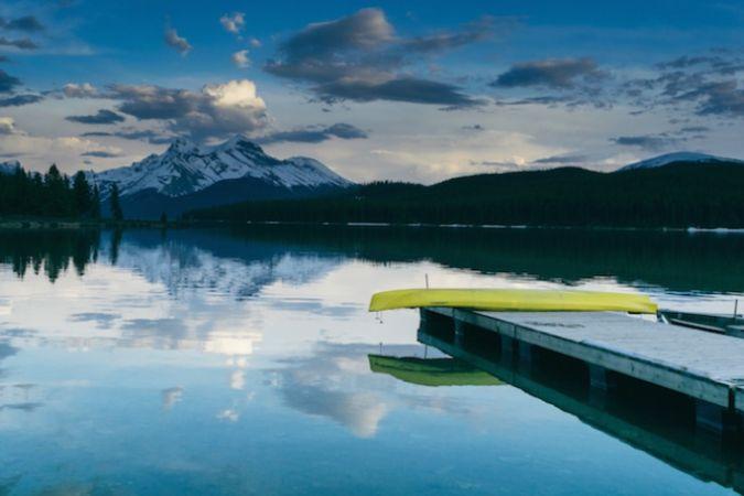 Mountains, lake and canoe