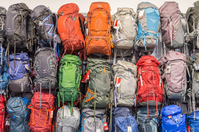 Backpacks stacked up in a shop