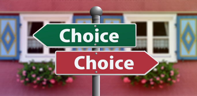 "Two signposts saying ""choice"" pointing opposite ways"
