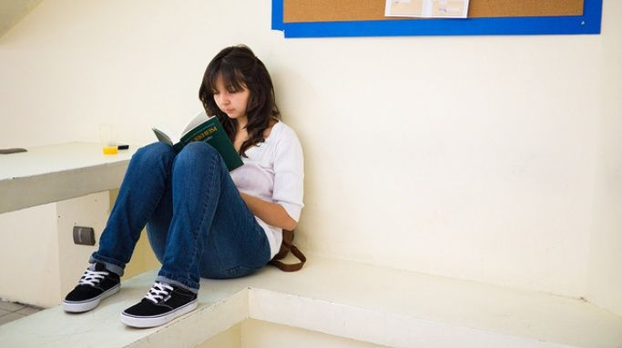Girl studying in a hallway