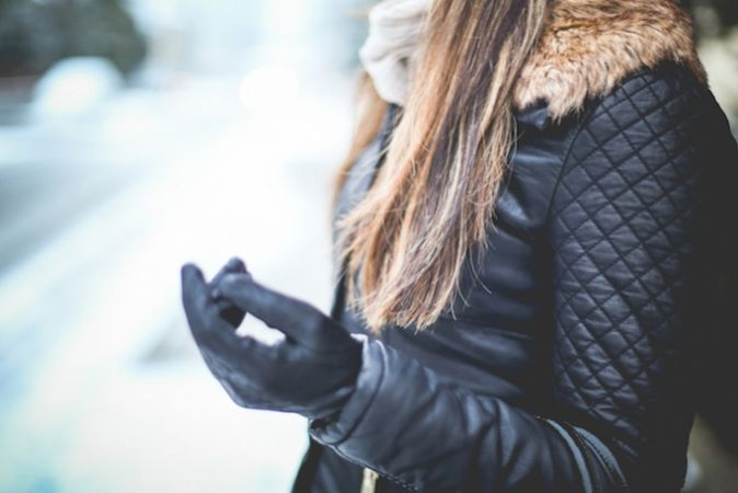 Young woman with leather gloves and jacket