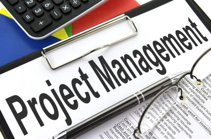 "A clipboard with a piece of paper saying ""project management"""