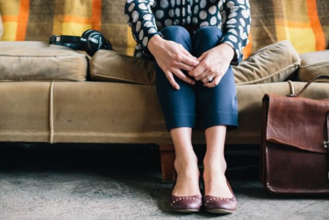 The right job interview tips would really help this woman waiting on a couch