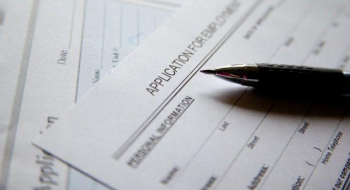 A job application form and pen